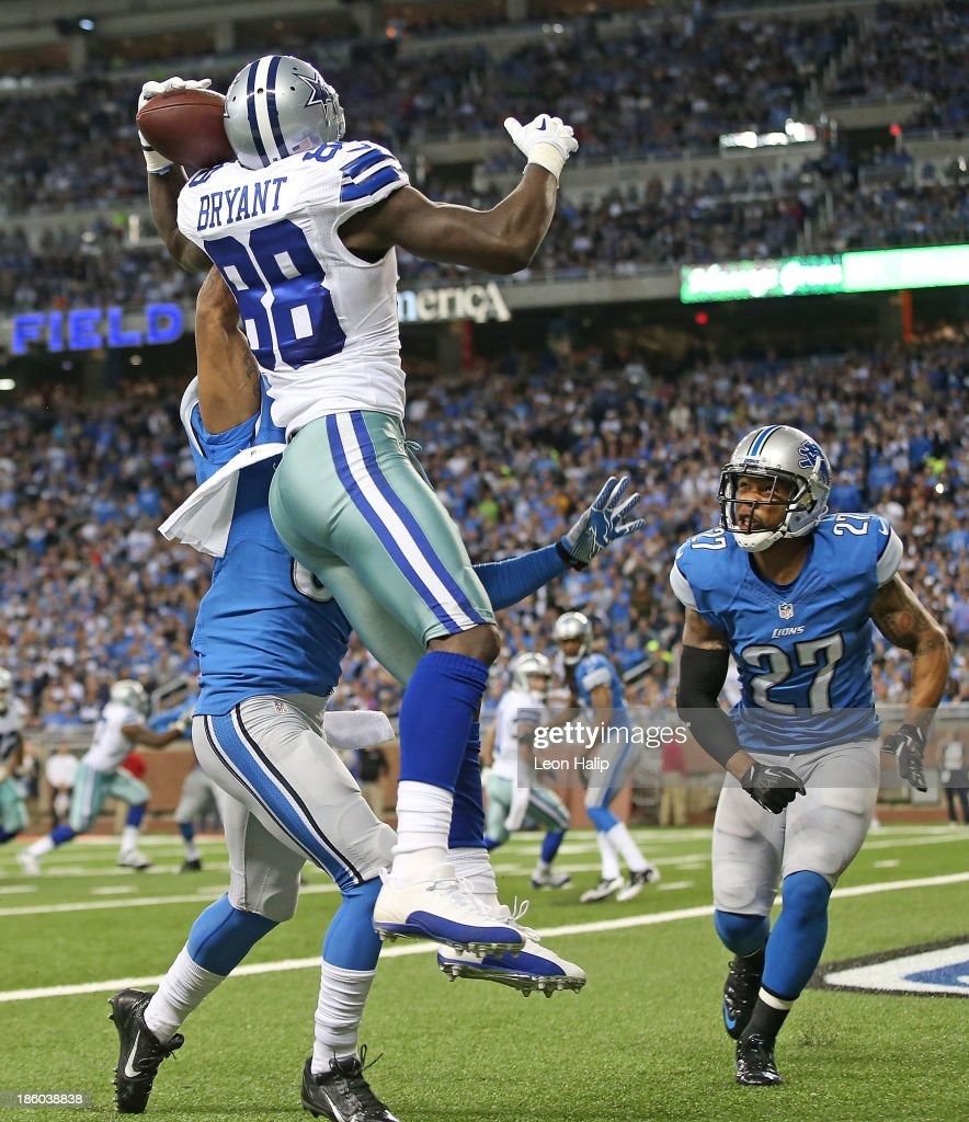 <a gi-track='captionPersonalityLinkClicked' href=/galleries/search?phrase=Dez+Bryant&family=editorial&specificpeople=4480158 ng-click='$event.stopPropagation()'>Dez Bryant</a> #88 of the Dallas Cowboys scores on a five yard touchdown pass from <a gi-track='captionPersonalityLinkClicked' href=/galleries/search?phrase=Tony+Romo&family=editorial&specificpeople=756503 ng-click='$event.stopPropagation()'>Tony Romo</a> #9 as <a gi-track='captionPersonalityLinkClicked' href=/galleries/search?phrase=Darius+Slay&family=editorial&specificpeople=8346374 ng-click='$event.stopPropagation()'>Darius Slay</a> #30 and <a gi-track='captionPersonalityLinkClicked' href=/galleries/search?phrase=Glover+Quin&family=editorial&specificpeople=5732643 ng-click='$event.stopPropagation()'>Glover Quin</a> #27 of the Detroit Lions defend during the second quarter ofd the game at Ford Field on October 27, 2013 in Detroit, Michigan.