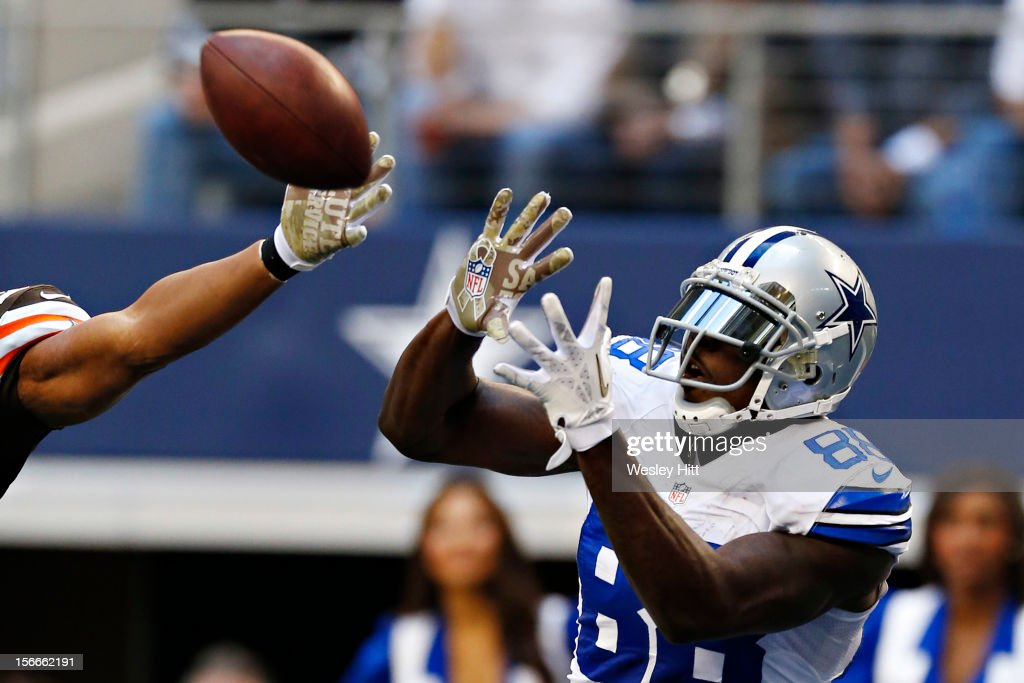 <a gi-track='captionPersonalityLinkClicked' href=/galleries/search?phrase=Dez+Bryant&family=editorial&specificpeople=4480158 ng-click='$event.stopPropagation()'>Dez Bryant</a> #88 of the Dallas Cowboys signals catches a touchdown pass against the Cleveland Browns at Cowboys Stadium on November 18, 2012 in Arlington, Texas. The Cowboys defeated the Browns 23-20.