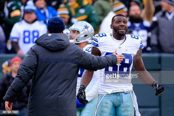 Dez Bryant of the Dallas Cowboys waits for a replay on a call late in the fourth quarter against the Green Bay Packers during the 2015 NFC Divisional...
