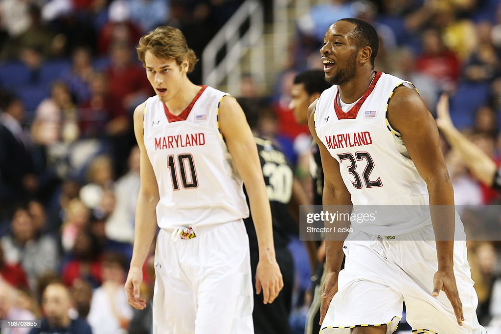 Dez Wells #32 and Jake Layman #10 of the Maryland Terrapins react against the Wake Forest Demon Deacons during the first round of the Men's ACC Basketball Tournament at Greensboro Coliseum on March 14, 2013 in Greensboro, North Carolina.