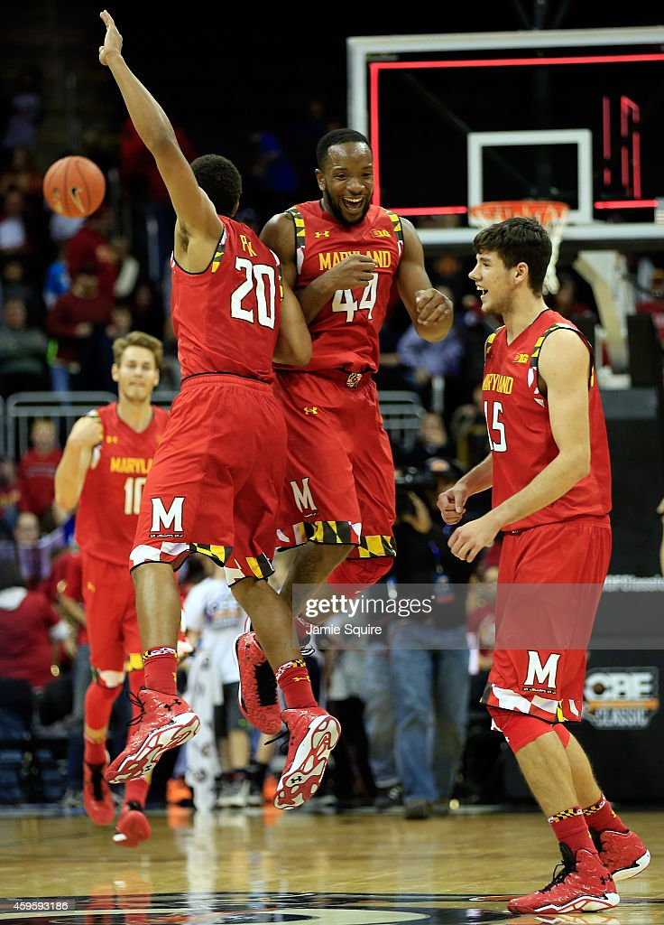 Dez Wells Michal Cekovsky and Richaud Pack of the Maryland Terrapins celebrate at the final buzzer as the Terrapins defeat the Iowa State Cyclones...