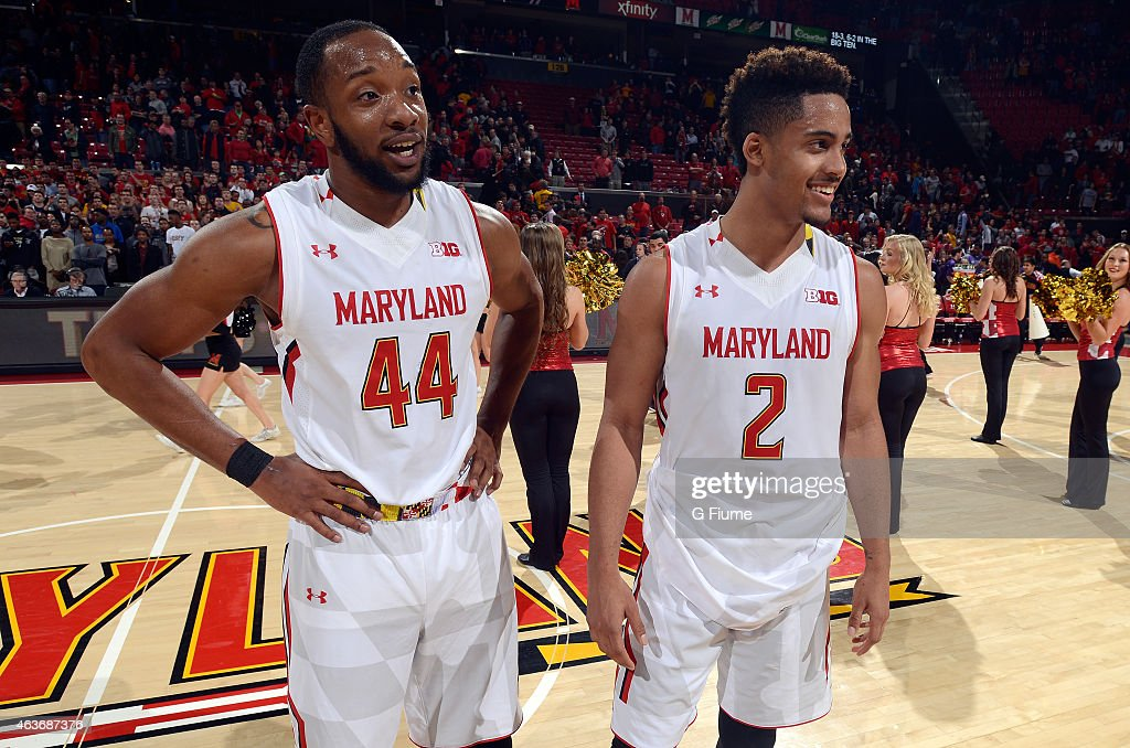 Dez Wells of the Maryland Terrapins celebrates with Melo Trimble after a victory against the Northwestern Wildcats at the Xfinity Center on January...