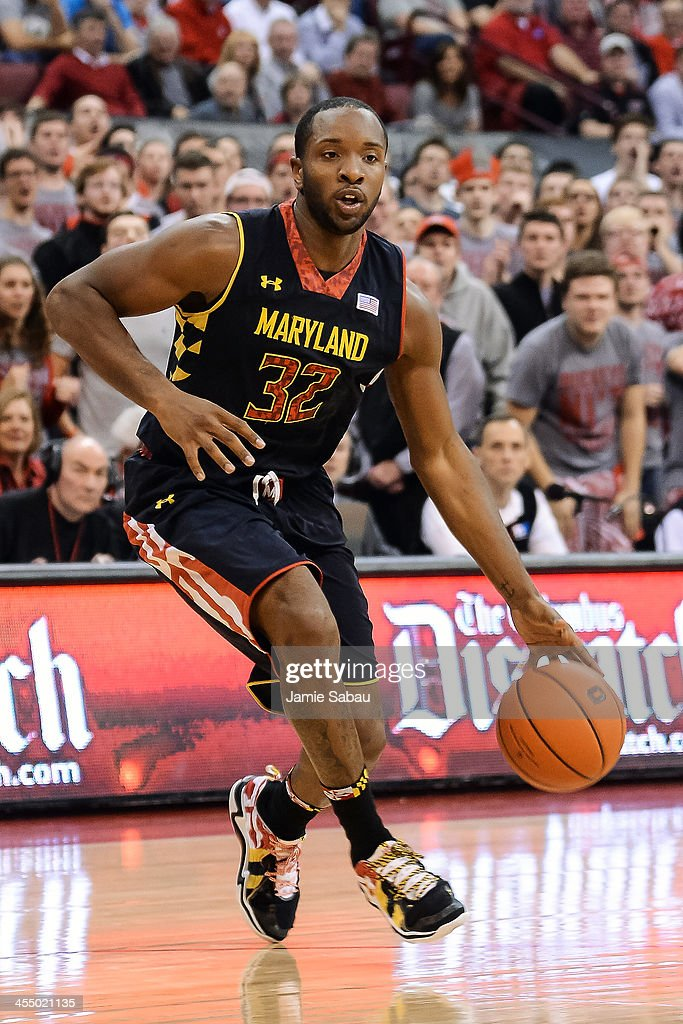 Dez Wells of the Maryland Terrapins controls the ball against the Ohio State Buckeyes on December 4 2013 at Value City Arena in Columbus Ohio Ohio...