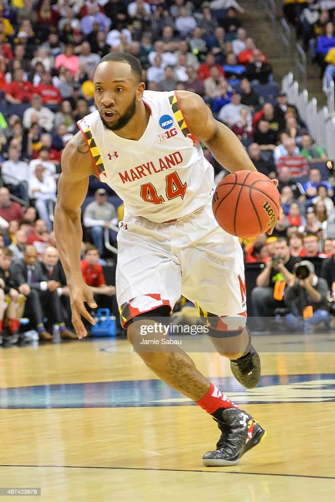 Dez Wells of the Maryland Terrapins controls the ball against the West Virginia Mountaineers during the third round of the 2015 NCAA Men's Basketball...
