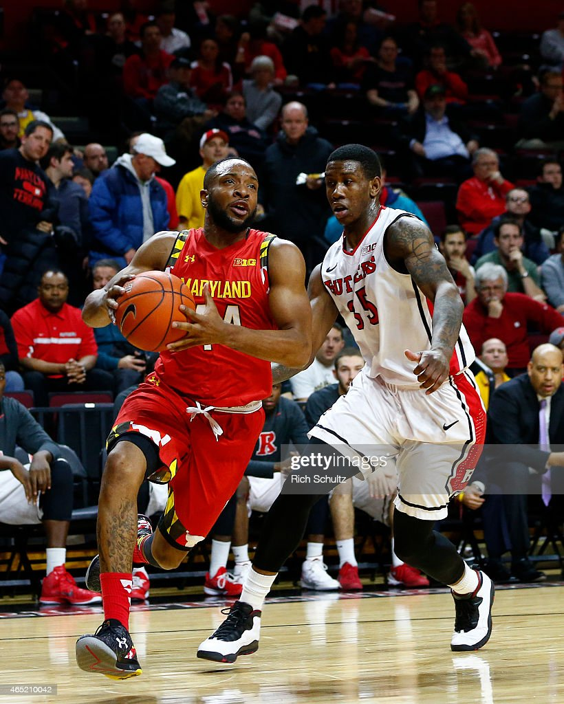 Dez Wells of the Maryland Terrapins dribbles to the basket as Greg Lewis of the Rutgers Scarlet Knights defends during the first half of a college...