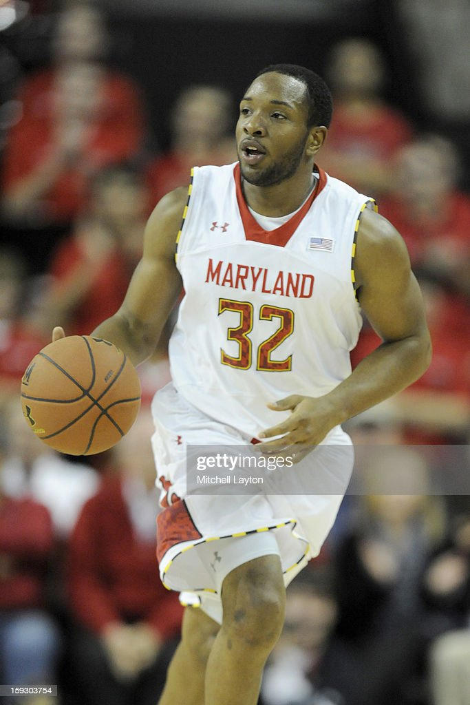 Dez Wells #32 of the Maryland Terrapins dribbles up court during a college basketball game against the Florida State Seminoles on January 9, 2013 at the Comcast Center in College Park, Maryland. The Seminoles won 65-62.