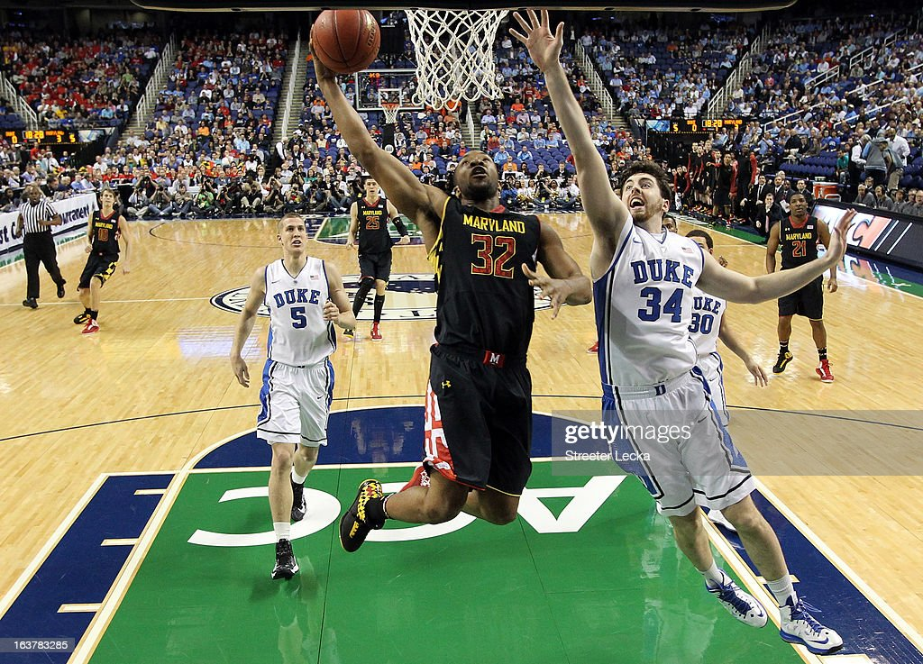 Dez Wells #32 of the Maryland Terrapins drives to the basket against <a gi-track='captionPersonalityLinkClicked' href=/galleries/search?phrase=Ryan+Kelly+-+Basketball+Player&family=editorial&specificpeople=15185169 ng-click='$event.stopPropagation()'>Ryan Kelly</a> #34 of the Duke Blue Devils during the quarterfinals of the Men's ACC Basketball Tournament at Greensboro Coliseum on March 15, 2013 in Greensboro, North Carolina.