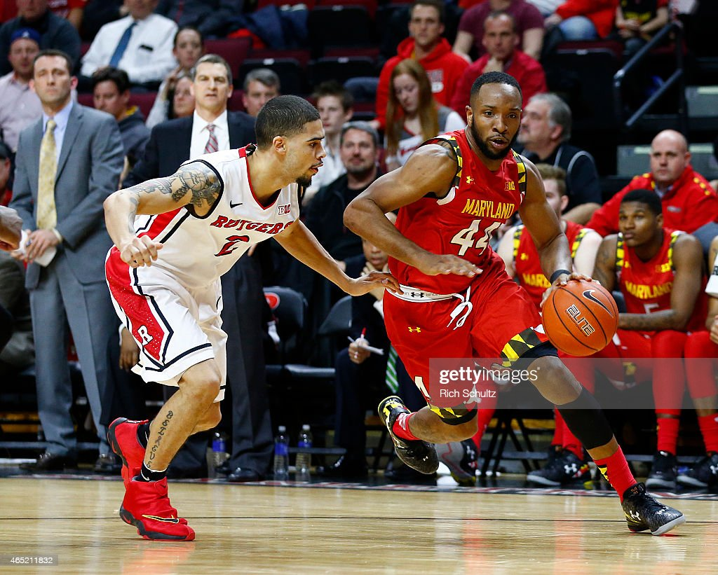 Dez Wells of the Maryland Terrapins drives to the basket as Bishop Daniels of the Rutgers Scarlet Knights defends during the second half of a college...