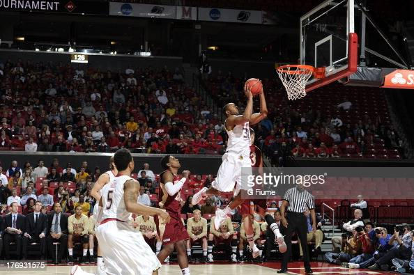 Dez Wells of the Maryland Terrapins drives to the hoop against the Denver Pioneers during the second round of the NIT Basketball Tournament at the...