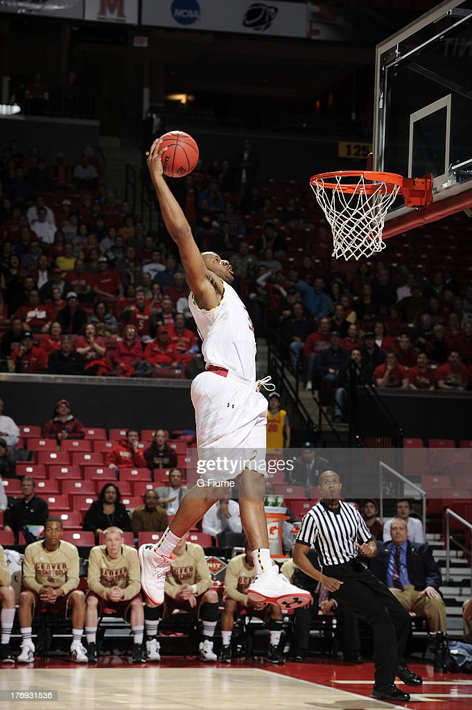 Dez Wells of the Maryland Terrapins dunks the ball against the Denver Pioneers during the second round of the NIT Basketball Tournament at the...