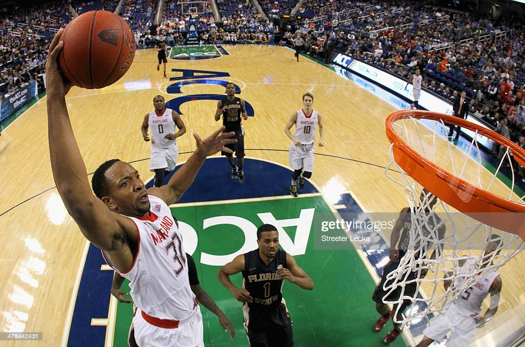 Dez Wells of the Maryland Terrapins dunks the ball against the Florida State Seminoles during the second round of the 2014 Men's ACC Basketball...