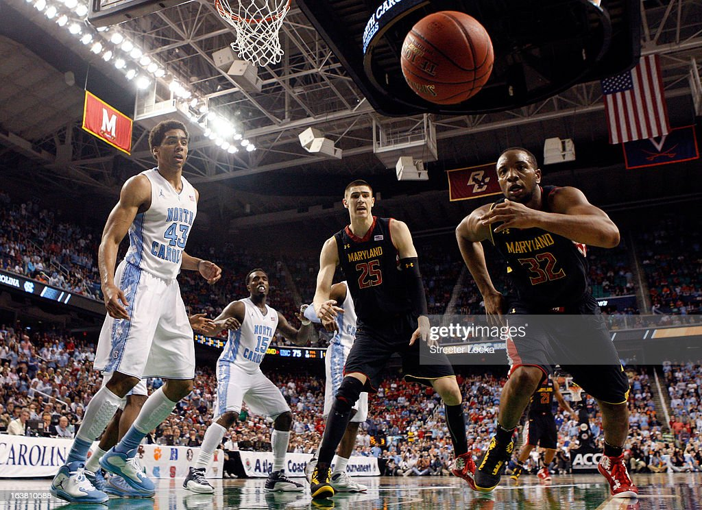 Dez Wells #32 of the Maryland Terrapins goes after a loose ball as James Michael McAdoo #43 of the North Carolina Tar Heels watches in the second half during the men's ACC Tournament semifinals at Greensboro Coliseum on March 16, 2013 in Greensboro, North Carolina.