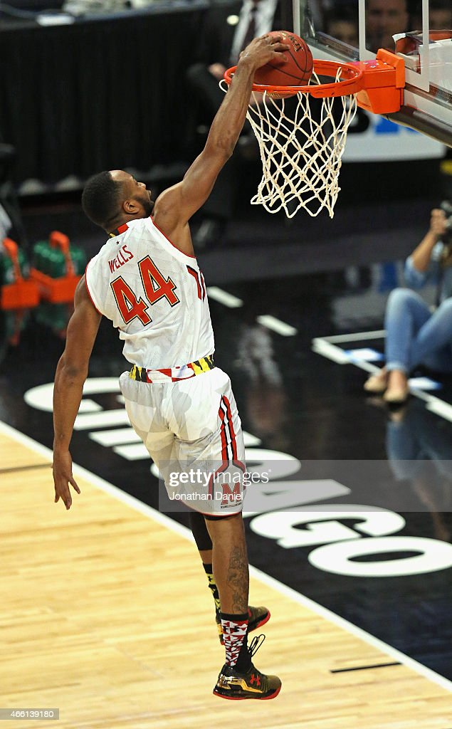 Dez Wells of the Maryland Terrapins goes up for a dunk against the Indiana Hoosiers during the quarterfinal round of the 2015 Big Ten Men's...