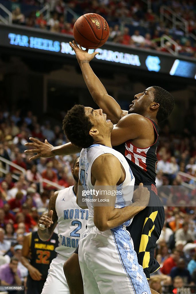 Dez Wells #32 of the Maryland Terrapins goes up for a shot against James Michael McAdoo #43 of the North Carolina Tar Heels in the first half during the men's ACC Tournament semifinals at Greensboro Coliseum on March 16, 2013 in Greensboro, North Carolina.