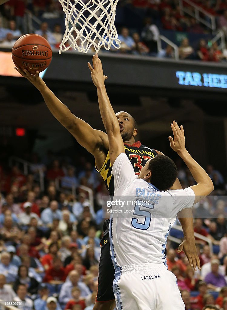 Dez Wells #32 of the Maryland Terrapins goes up for a shot against Marcus Paige #5 of the North Carolina Tar Heels in the first half during the men's ACC Tournament semifinals at Greensboro Coliseum on March 16, 2013 in Greensboro, North Carolina.