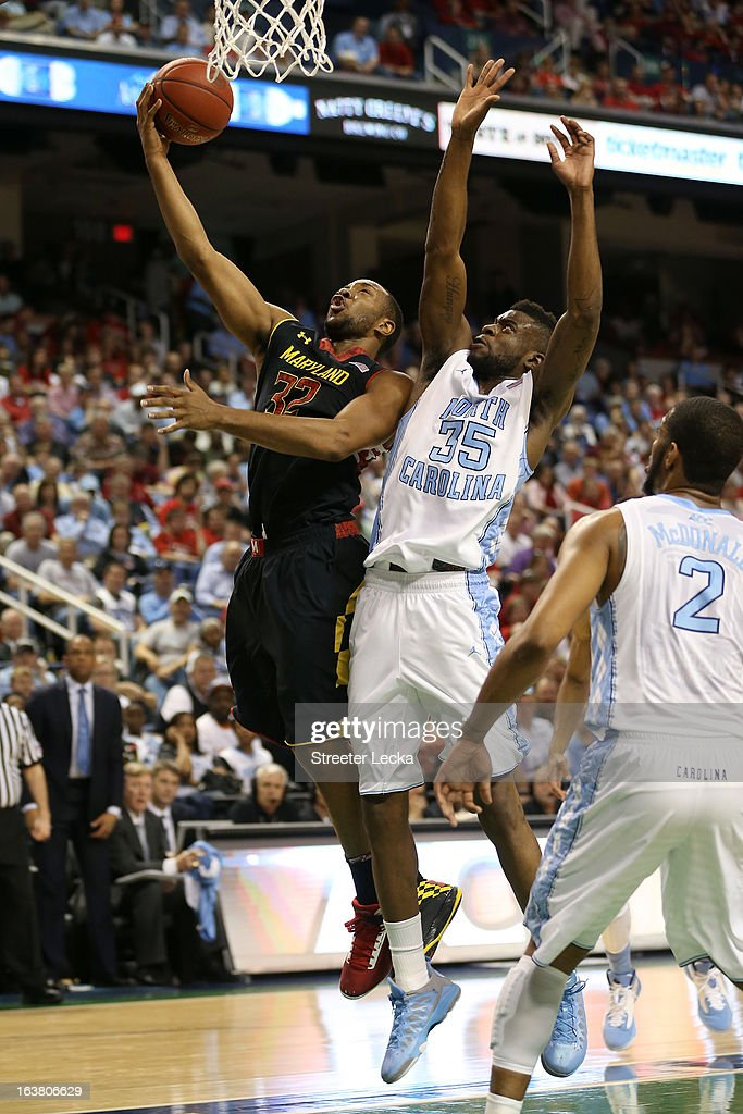 Dez Wells #32 of the Maryland Terrapins goes up for a shot in front of Reggie Bullock #35 of the North Carolina Tar Heels in the first half during the men's ACC Tournament semifinals at Greensboro Coliseum on March 16, 2013 in Greensboro, North Carolina.