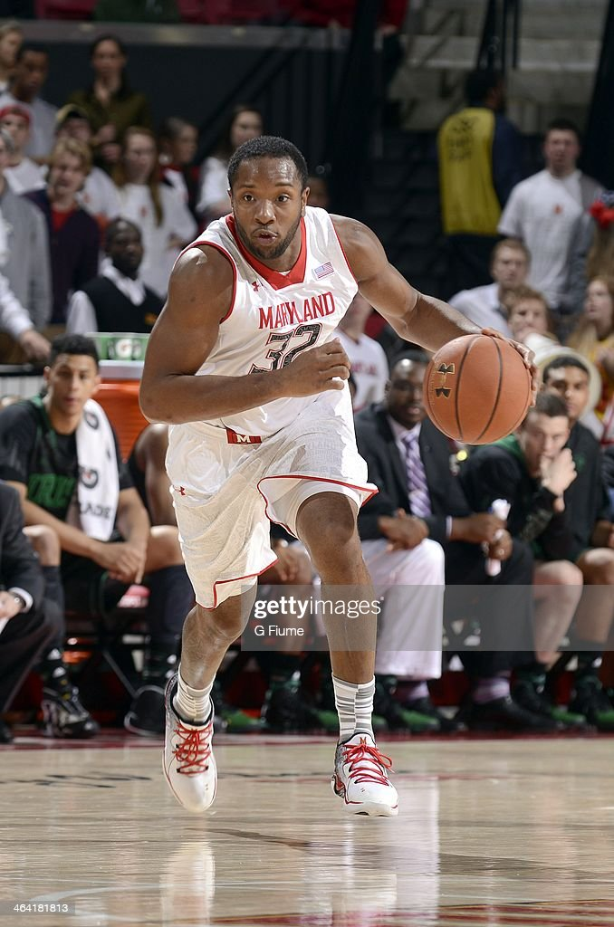 Dez Wells of the Maryland Terrapins handles the ball against the Notre Dame Fighting Irish at the Comcast Center on January 15 2014 in College Park...