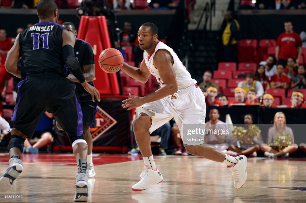 Dez Wells of the Maryland Terrapins handles the ball during the first round of the NIT Basketball Tournament against the Niagara Purple Eagles at the...