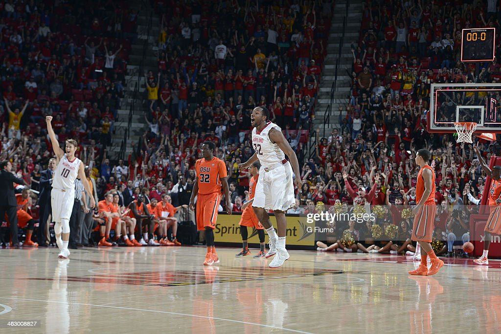Dez Wells #32 of the Maryland Terrapins reacts after making a half-court basket to end the first half against the Oregon State Beavers at the Comcast Center on November 17, 2013 in College Park, Maryland. The Beavers won 90-83.