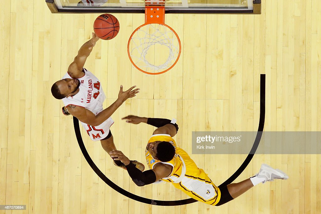 Dez Wells of the Maryland Terrapins takes a shot over Darien Walker of the Valparaiso Crusaders during the second round of the Men's NCAA Basketball...