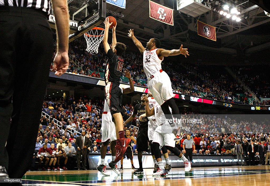 Dez Wells of the Maryland Terrapins tries to block Boris Bojanovsky of the Florida State Seminoles as he makes the game winning dunk to defeat the...