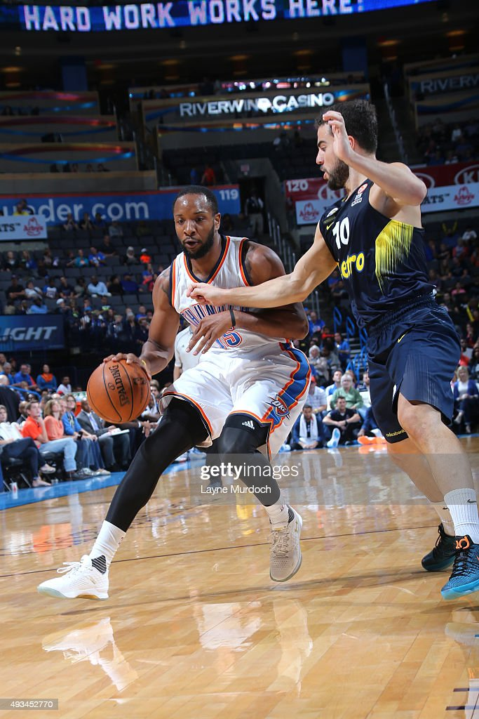 Dez Wells of the Oklahoma City Thunder drives to the basket against the Fenerbahce Ulker during a preseason game on October 9 2015 at Chesapeake...