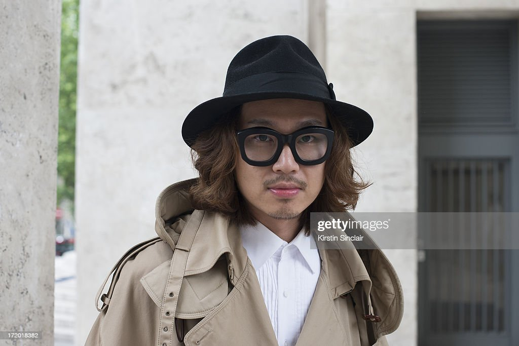 Dgnak merchandising manager Kiryong Han wears a Juun J jacket, Dgnak shirt, Christy's hat and Kuboraum glasses on day 3 of Paris Collections: Men on June 28, 2013 in Paris, France.