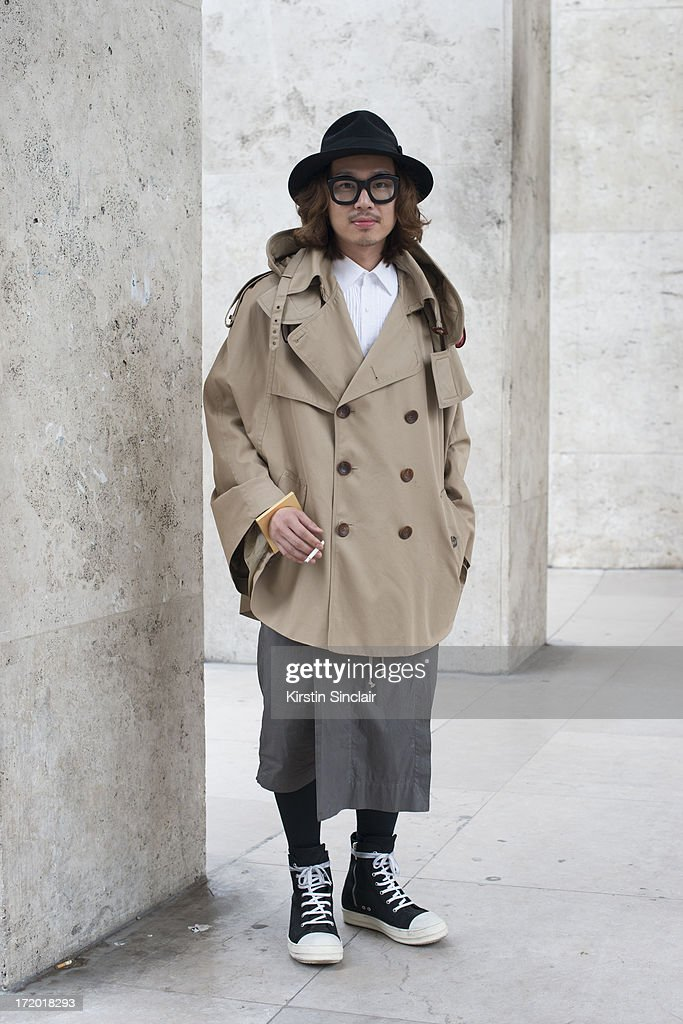 Dgnak merchandising manager Kiryong Han wears Rick Owens trainers and shorts, Juun J jacket, Dgnak shirt, Christy's hat and Kuboraum glasses on day 3 of Paris Collections: Men on June 28, 2013 in Paris, France.