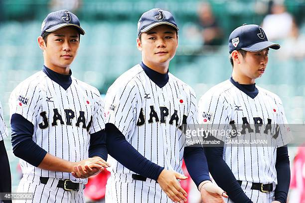 Dh Kotaro Kiyomiya lines up for national anthem in the super round game between Japan v Cuba during the 2015 WBSC U18 Baseball World Cup at the...
