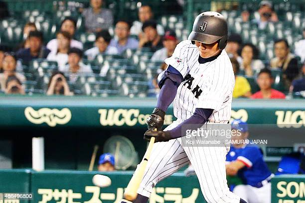 Dh Kotaro Kiyomiya of Japan hits a single in the bottom half of the fifth inning the game between Australia and Japan in the super round game between...