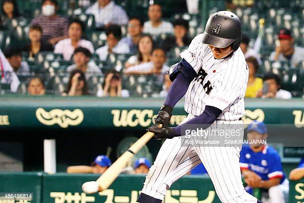 Dh Kotaro Kiyomiya of Japan hits a single in the bottom half of the sixth inning the game between Australia and Japan in the super round game between...
