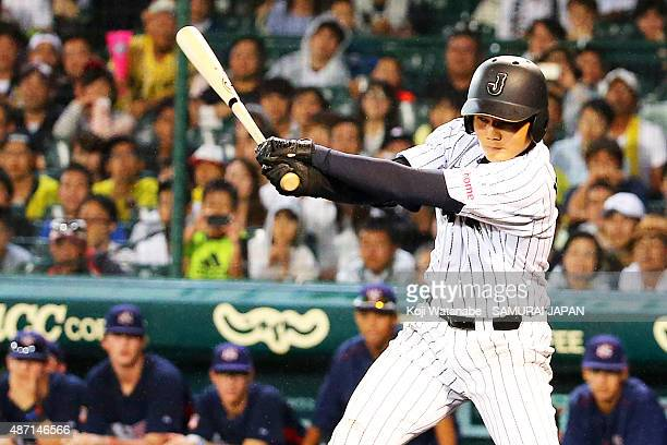 Dh Kotaro Kiyomiya of Japan hits a single in the bottom half of the sixth inning in the Gold Medal game between Japan and USA during the 2015 WBSC...