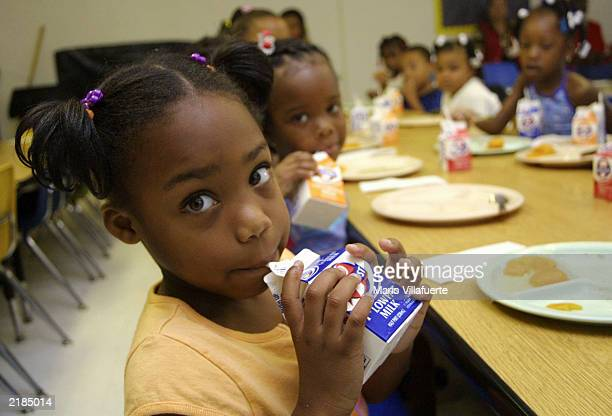 Dhaija Smith finishes her milk during breakfast with her classmates at the Brown E Moore Head Start Center July 22 2003 in Shreveport Louisiana...