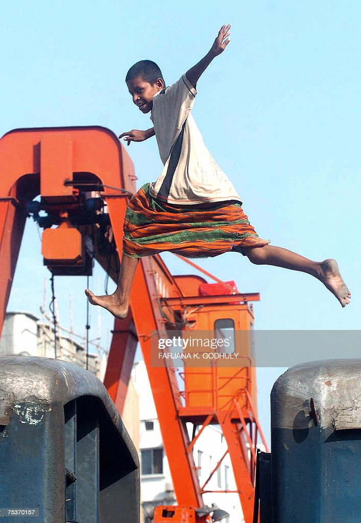 A Bangladeshi boy jumps between train compartments at the Cantonment railway station in Dhaka, 12 July 2007. Railway officials of Bangladesh and India agreed in principle on commissioning the Dhaka-Kolkata passenger train service ahead of Ramadan, in a follow-up to the 08 July's cross-border trial run. AFP PHOTO/Farjana K. GODHULY