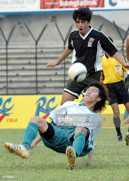 Macau football player LAO Pak Kin fights for the ball with Pakistan opponent Essa Muhammad during a match between Pakistan and Macau in the Asian...