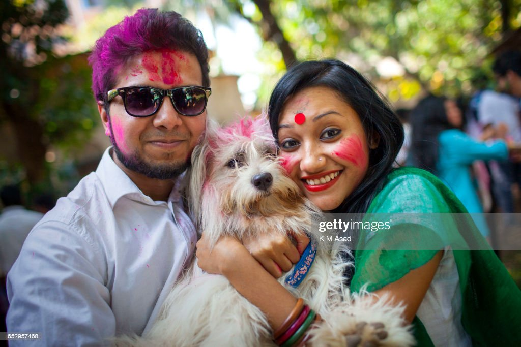 UNIVERCITY, DHAKA, BANGLADESH - : Dhaka University fine Art Student with dog celebrate the Holi Festival or Festival of Colors after smearing each other with colored powder in Dhaka, Bangladesh. Holi festival is celebrated on the full moon day in the month of Phalguna and marks the start of the spring season.