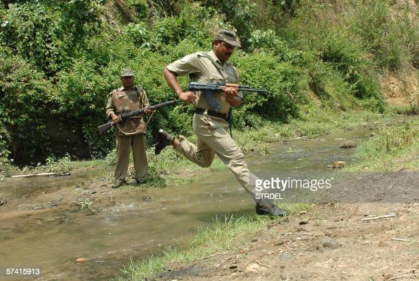 Indian paramilitary soldiers conduct a combing operation after militants killed a truck driver and injured five others seriously in an ambush late 24...