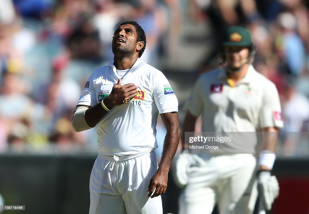 Dhammika Prasad of Sri Lanka celebrates his dismissal of Ed Cowan of Australia during day one of the Second Test match between Australia and Sri Lanka at Melbourne Cricket Ground on December 26, 2012 in Melbourne, Australia.