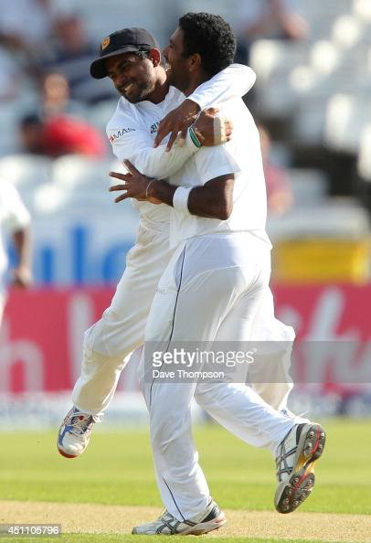 Dhammika Prasad of Sri Lanka is congratulated by Kaushal Silva of Sri Lanka after he bowled out Ian Bell of England during day four of the 2nd...