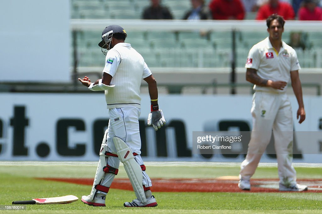 Dhammika Prasad of Sri Lanka looks at his hand after he was struck by a Mitchell Johnson delivery during day three of the Second Test match between Australia and Sri Lanka at Melbourne Cricket Ground on December 28, 2012 in Melbourne, Australia.