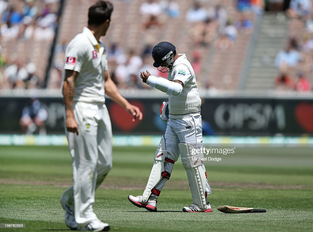 Dhammika Prasad (R) of Sri Lanka sustains a finger injury off the bowling of Mitchell Johnson of Australia who looks back at him during day three of the Second Test match between Australia and Sri Lanka at Melbourne Cricket Ground on December 28, 2012 in Melbourne, Australia.