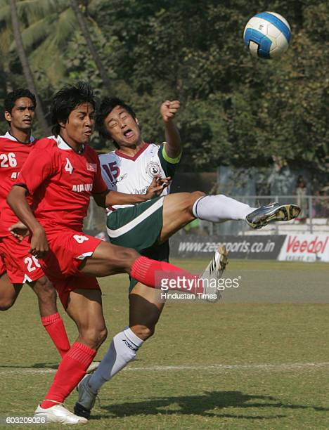 Dhanchandra Singh of Air India clashes with Mohan Bagan's Bhaichung Bhutia during their I_League football match at Cooperage ground on Sunday