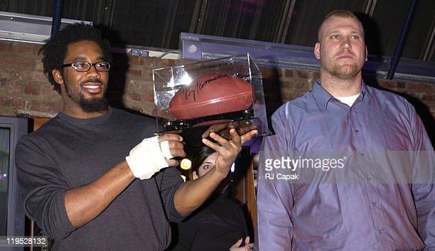 Dhani Jones Jason Fabini with Joe Namath signed football some of the sports memorabilia being auctioned off