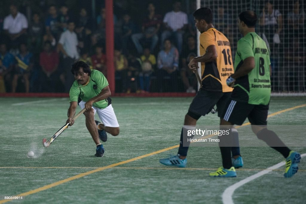 Former Hockey Player Dhanraj Pillai In Action During Exhibition Match