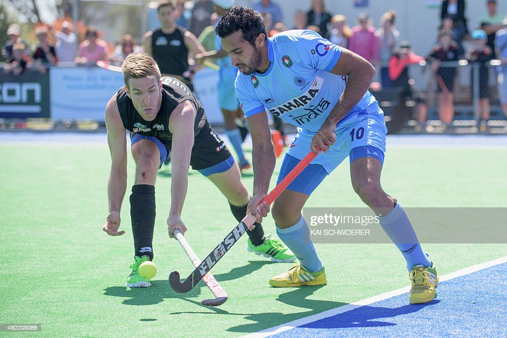 <a gi-track='captionPersonalityLinkClicked' href=/galleries/search?phrase=Dharamvir+Singh+-+Field+Hockey+Player&family=editorial&specificpeople=16041870 ng-click='$event.stopPropagation()'>Dharamvir Singh</a> of India controls the ball from James Coughlan of New Zealand during the international men's hockey test match between the New Zealand Black Sticks and India on October 11, 2015 in Christchurch, New Zealand.