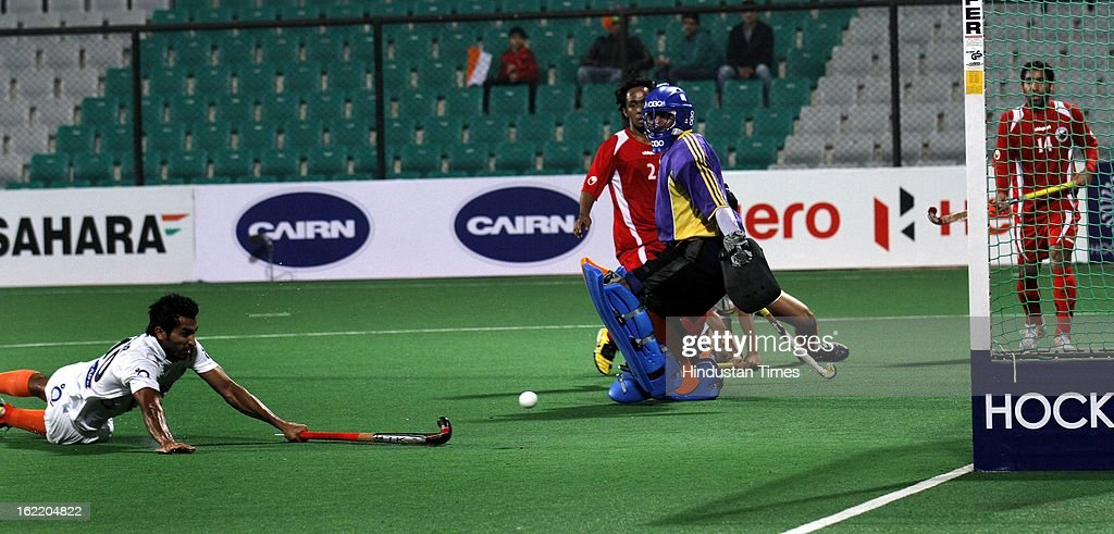 Dharamvir Singh of India push the ball to score a goal against Oman during Hockey World League round 2 at Major Dhyan Chand stadium on February 20, 2013 in New Delhi, India. Indians mauled Oman side by 9-1.