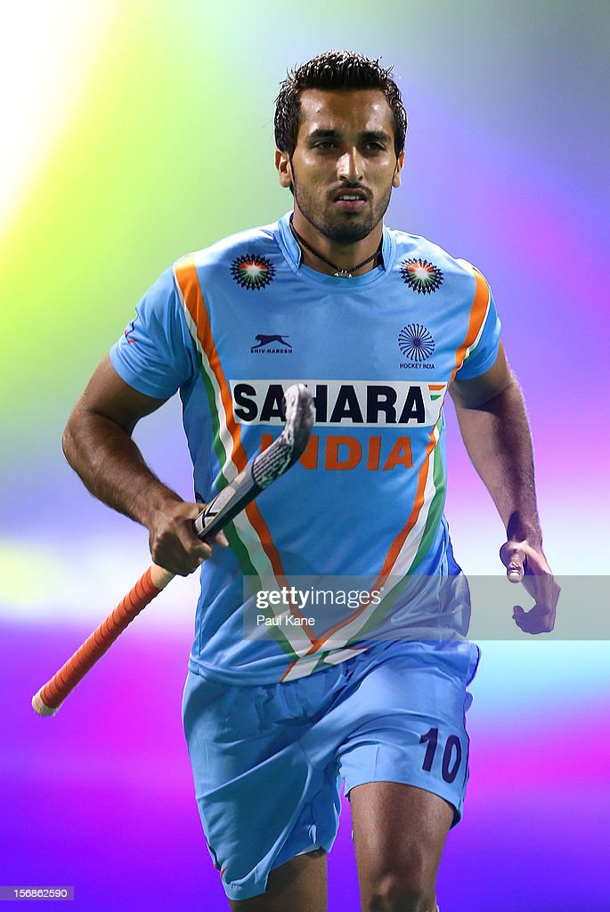 <a gi-track='captionPersonalityLinkClicked' href=/galleries/search?phrase=Dharamvir+Singh+-+Field+Hockey+Player&family=editorial&specificpeople=16041870 ng-click='$event.stopPropagation()'>Dharamvir Singh</a> of India runs onto the field for the start of the mens Australia Kookaburras v India game during day two of the 2012 International Super Series at Perth Hockey Stadium on November 23, 2012 in Perth, Australia.