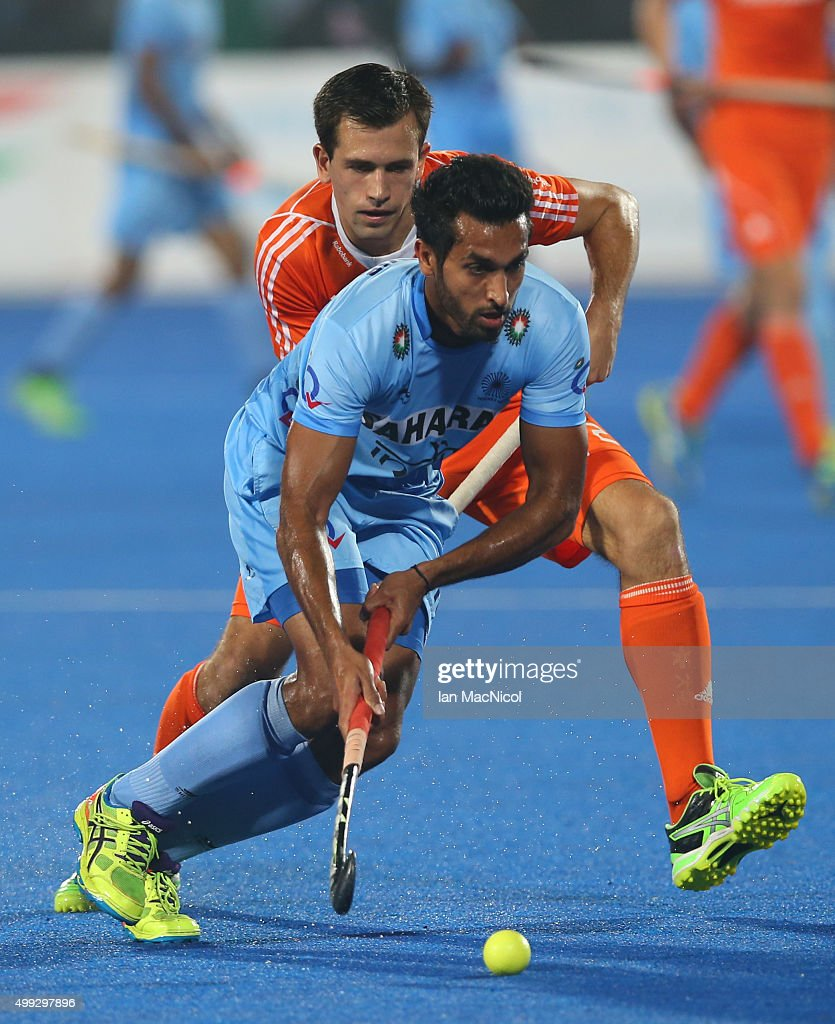 <a gi-track='captionPersonalityLinkClicked' href=/galleries/search?phrase=Dharamvir+Singh+-+Field+Hockey+Player&family=editorial&specificpeople=16041870 ng-click='$event.stopPropagation()'>Dharamvir Singh</a> of India runs with the ball during the match between Netherlands and India on day four of The Hero Hockey League World Final at the Sardar Vallabh Bhai Patel International Hockey Stadium on November 30, 2015 in Raipur, India.