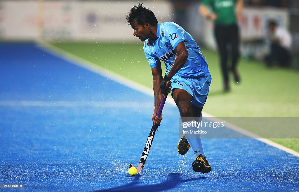 <a gi-track='captionPersonalityLinkClicked' href=/galleries/search?phrase=Dharamvir+Singh+-+Field+Hockey+Player&family=editorial&specificpeople=16041870 ng-click='$event.stopPropagation()'>Dharamvir Singh</a> of India runs with the ball during the match between Netherlands and India on day ten of The Hero Hockey League World Final at the Sardar Vallabh Bhai Patel International Hockey Stadium on December 06, 2015 in Raipur, India.