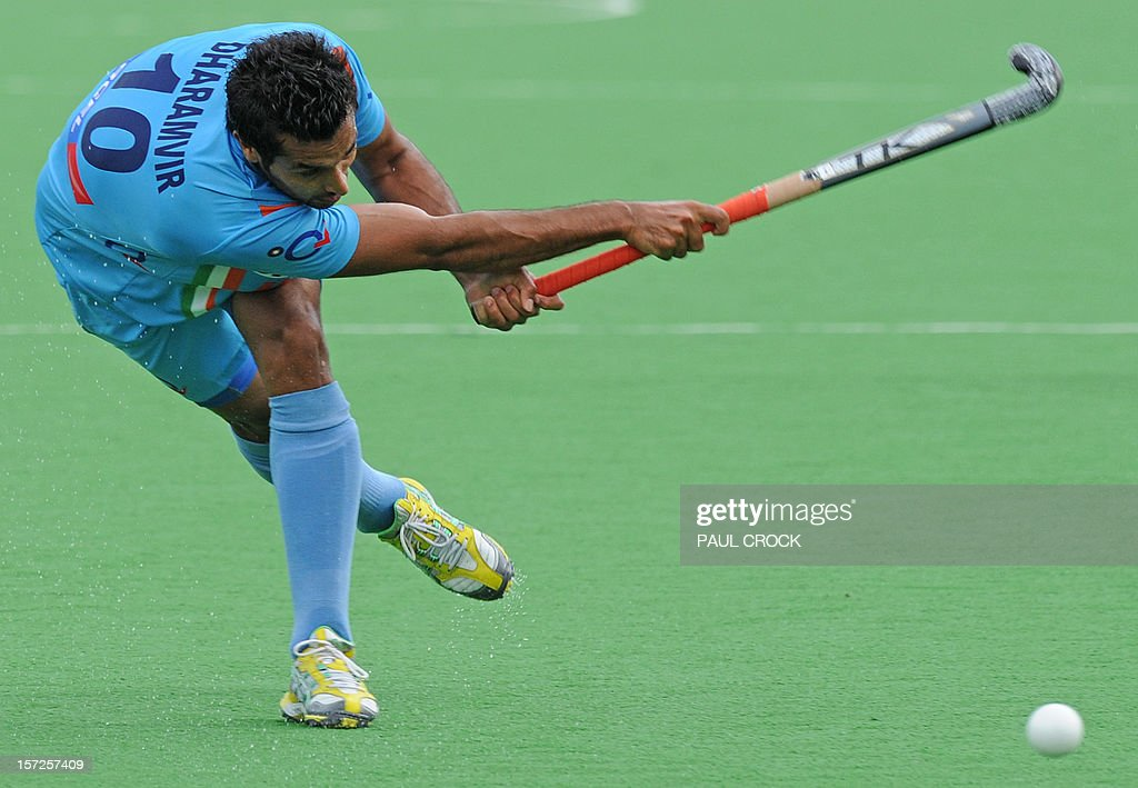 <a gi-track='captionPersonalityLinkClicked' href=/galleries/search?phrase=Dharamvir+Singh+-+Field+Hockey+Player&family=editorial&specificpeople=16041870 ng-click='$event.stopPropagation()'>Dharamvir Singh</a> of India strikes the ball during the pool B match between India and England at the Mens Hockey Champioships Trophy in Melbourne on December 1, 2012. India won the match 3-1. RESTRICTED TO EDITORIAL USE NO ADVERTISING USE NO PROMOTIONAL USE NO MERCHANDISING USE. AFP PHOTO/Paul CROCK